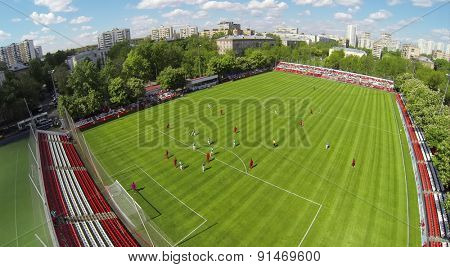 RUSSIA, BOGORODSKOE  - MAY 14, 2014: Soccer teams play on field of Spartakovec stadium named by N.P. Starostin during international competition. Aerial view