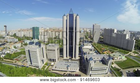 RUSSIA, MOSCOW - MAY 16, 2014: Business complex with tall building against cityscape at spring sunny day. Aerial view.