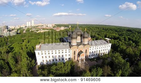 RUSSIA, MOSCOW - MAY 23, 2014: Cathedral of Intercession of Blessed Virgin Mary among plants near city at spring sunny day. Aerial view.