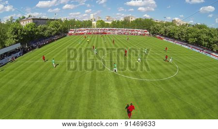 RUSSIA, BOGORODSKOE  - MAY 14, 2014: Players pass ball on soccer field of Spartakovec stadium named by N.P. Starostin during international competition. Aerial view