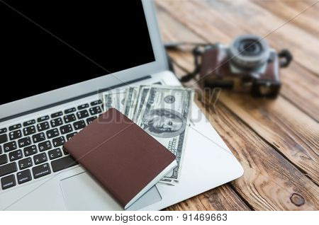 Passport with us dollars on laptop