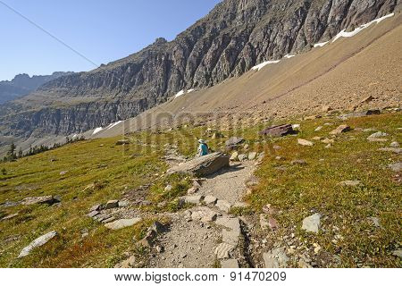 Hiker Relaxing On A Mountain Trail