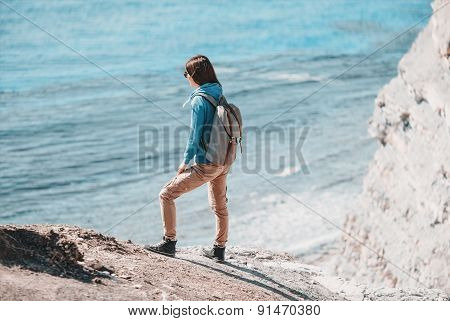 Young Woman Standing On Coast In Summer