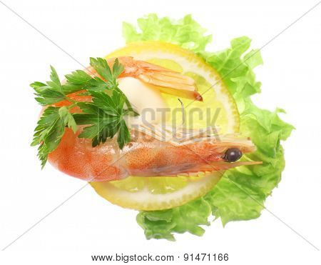 Boiled shrimp with lemon and lettuce isolated on white
