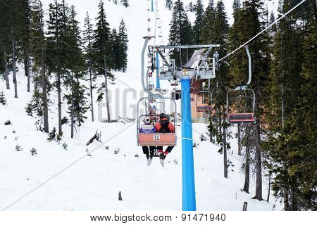 Cableway over mountains in wintertime