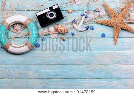 Beach accessories on wooden background