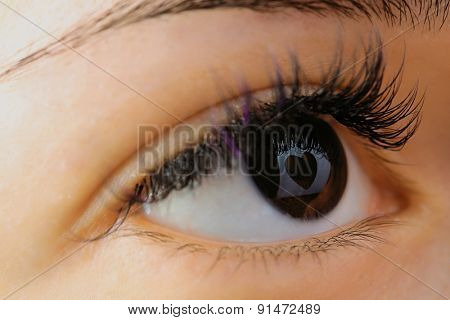 Reflection heart in an eye close-up