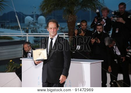 Actor Vincent Lindon, winner of the Best Actor Prize,  the film ' La Loi du Marche' . photocall for the winners of the Palm D'Or . 68th annual Cannes Film Festival on May 24, 2015 in Cannes, Franceâ?¦