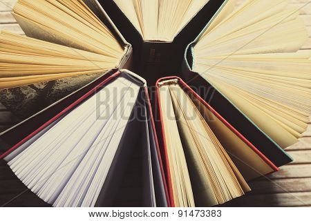 Group of books on wooden background, top view