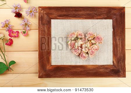 Heart of beautiful dry flowers in frame