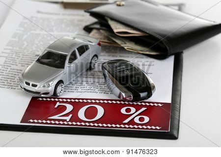 Tablet, purse and toy car isolated on white