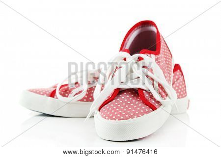 Pink shoes isolated on white