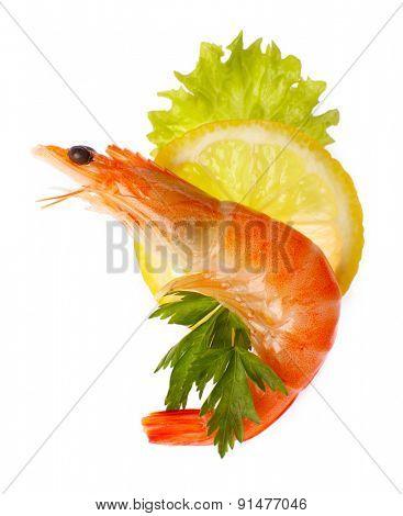 Boiled shrimp with lemon and parsley isolated on white