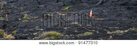 Construction Cone On A Lava Field
