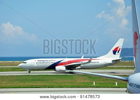 Malaysia airlines plane Boeing 737-800 takes off at Kota Kinabalu airport
