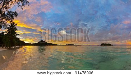 Tropical beach Cote d'Or at Seychelles on sunset - vacation background