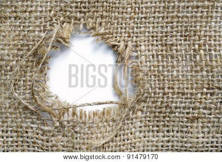 Sackcloth with a patched hole