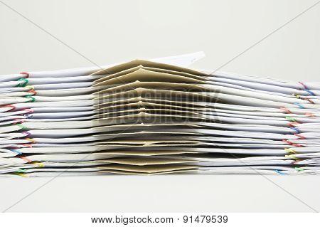 Pile Of Brown Envelope Between Paperwork