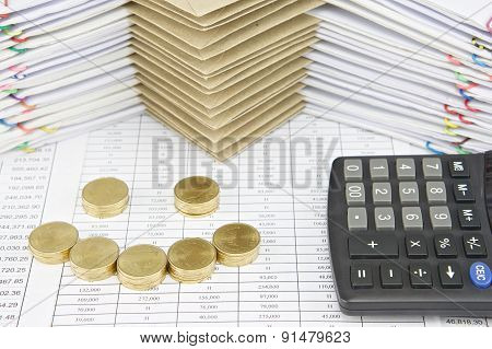 Pile Of Gold Coins As Smile With Calculator