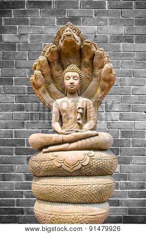Buddha Image On Old Brick Wall Background