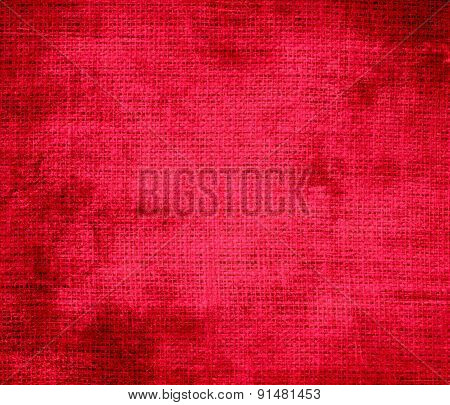 Grunge background of carmine red burlap texture