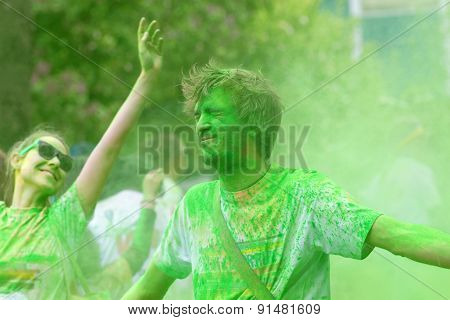 Man Receiving Green Color Powder And Happy Girl