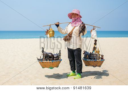 Phuket, Thailand - January 26,2015: Thai woman selling beachwear and souvenirs at beach in Phuket, Thailand.