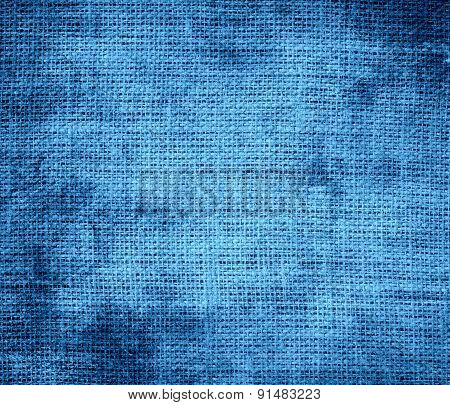 Grunge background of celestial blue burlap texture