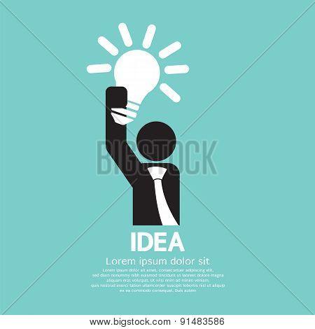 Businessman Holding A Light Bulb Idea Concept.