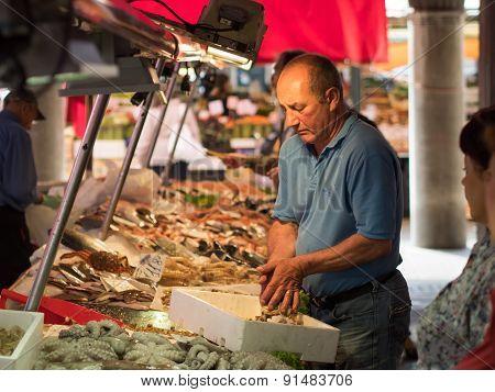 Venice, Italy - 20 May 2105: Rialto Fish Markets. Fishmonger At Work.