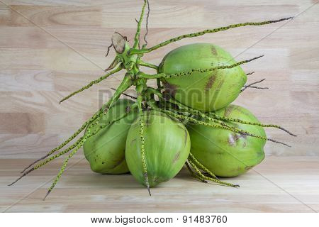 Green Coconuts On Wood Background