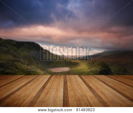 View From Mount Snowdon Towards Carneddau Mountain Range During Sunset With Wooden Planks Floor