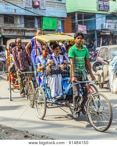 Rickshaw Rider Transports Passenger In Old Delhi, India.