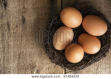 Fresh Eggs In Birds Nest In Vintage Retro Style Moody Natural Lighting Set Up