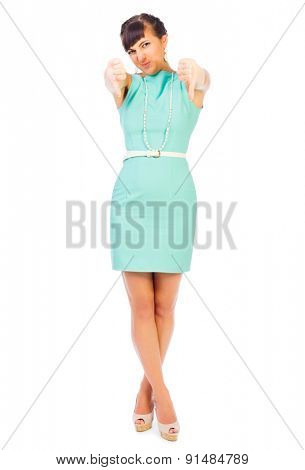 Glamorous girl in turquoise dress shows negative gesture isolated
