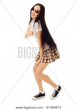 Schoolgirl in plaid skirt isolated