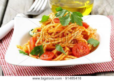 Italian traditional pasta - spaghetti with tomato sauce