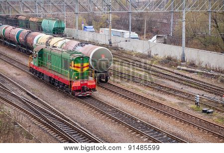Railway With Green Locomotive And Cargo Trains