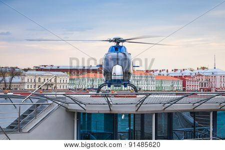 Small Blue Helicopter Stands On The Floating Helipad