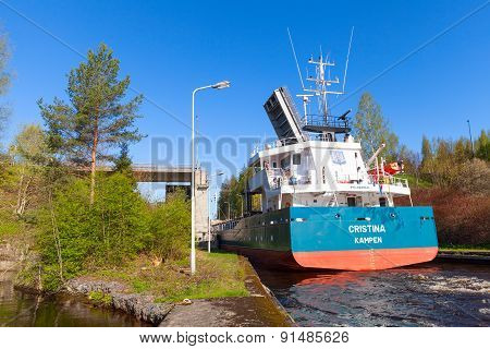 Cargo Ship Comes To The Narrow Gateway Of The Lock