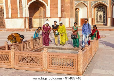 Indian Tourists Pose For A Photo At Humayuns Tomb