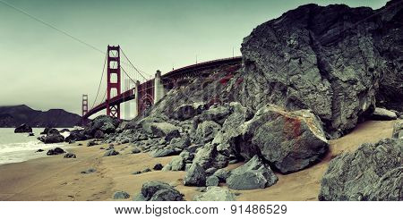 Golden Gate Bridge with rock panorama in San Francisco as the famous landmark.