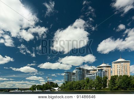 Abstract urban view with residential buildings yaht club and blue skies
