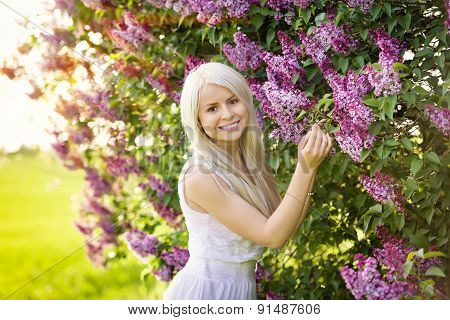 Beautiful Smiling Young Woman With Lilac Flowers