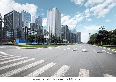 Empty urban road and modern skyline