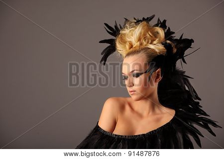 Portrait Of Woman Shaman With Raven Feather In Her Hair