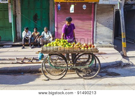 Man Sells Fruits At The Vegetable Street Market In Delhi
