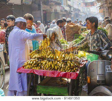 Man Sells Bananas At The Old Vegetable Street Market In Delhi