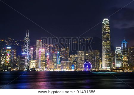 illuminated skyscrapers in victoria harbor,hongkong.