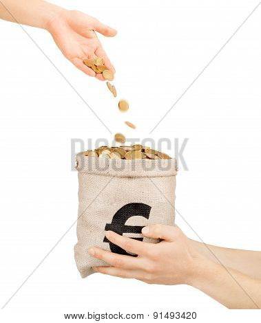 Coins Falling From Hand Into The Bag With Coins